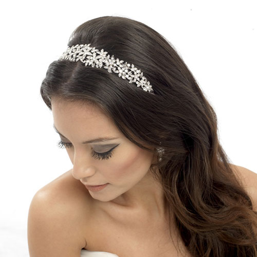 This elegant floral wedding headband has a beautiful design decorated with sparkling clear crystals.