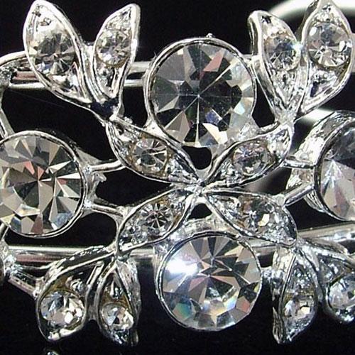 The Amanda Wyatt JE54 Crystal Wedding Bracelet is a beautiful torc style bangle. Amanda Wyatt JE54 has a striking design comprising round cut crystal diamante and crys